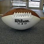 After: Signed football worthy of fireplace mantle once again