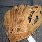Before: Ball glove in need of repair